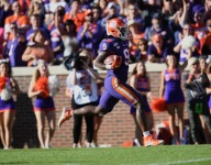 Higgins finds end zone, Etienne continues record breaking day
