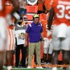 Clemson player comes off bus with boot